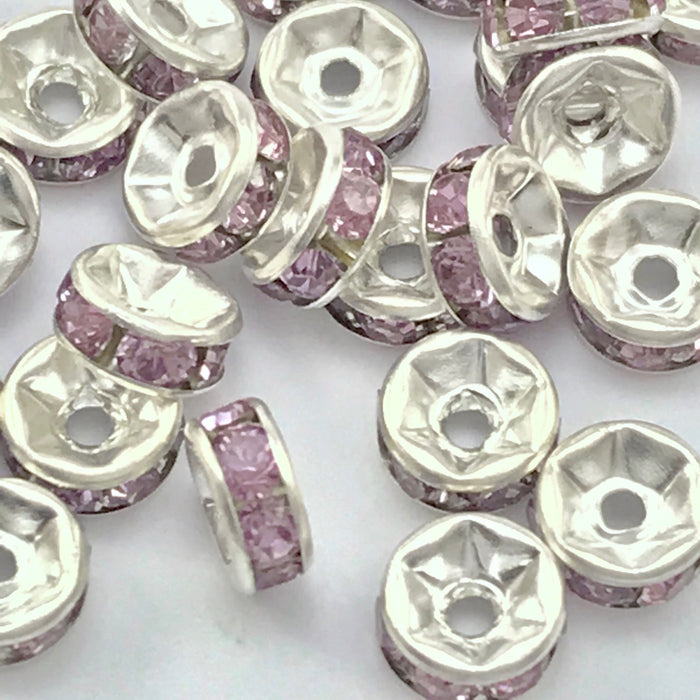 pile of silver and violet color rondelle jewelry beads