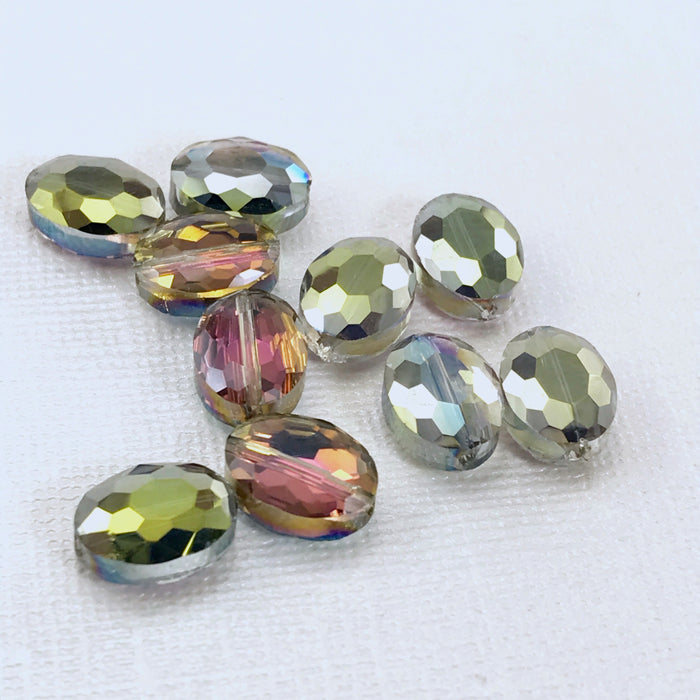 oval shaped glas beads that are a purple and green color