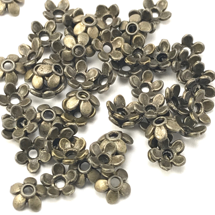 pile of bronze colour bead caps shaped like flowers
