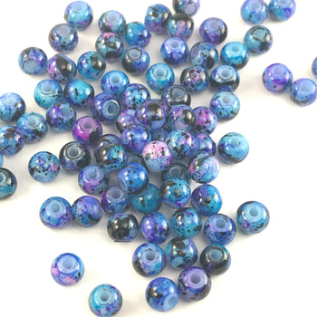 round jewelry beads that have a blue marbled appearance