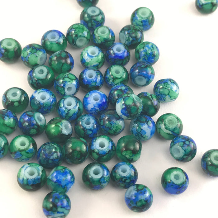 round jewelry beads that have a green and blue marble appearance