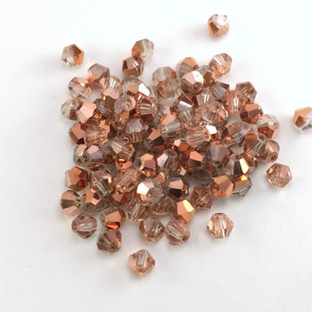 rose gold colour bicone shaped jewelry beads