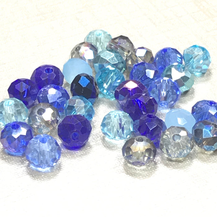 mixture of rondelle shaped jewerly beads in different shades of blue