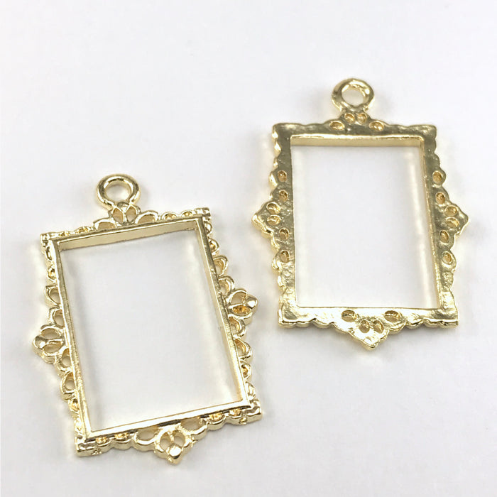 front and back of open resin bezel in a rectangle frame shape