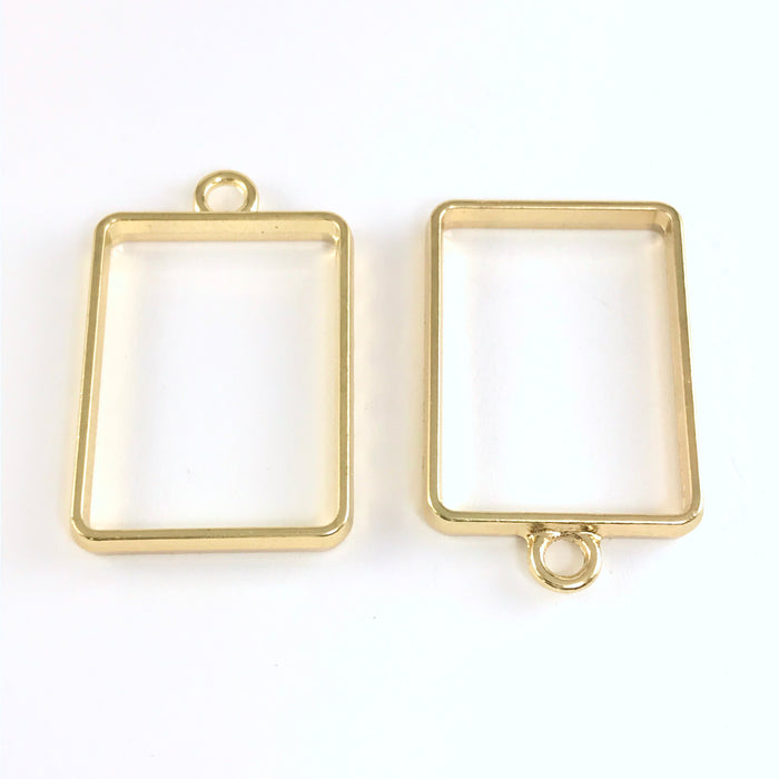 front and back of rectangle gold colour open bezel with loop