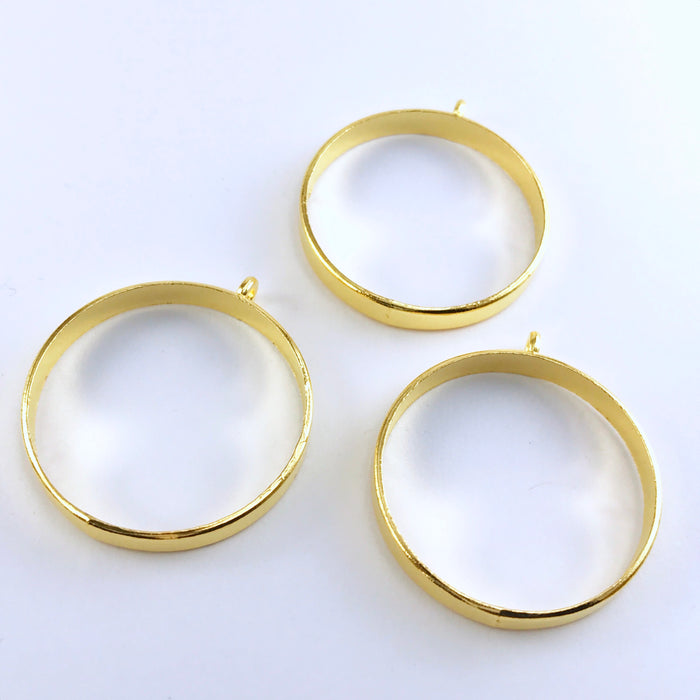 3 gold round open back bezels