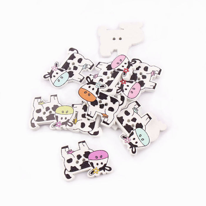 wooden buttons with cows printed on them
