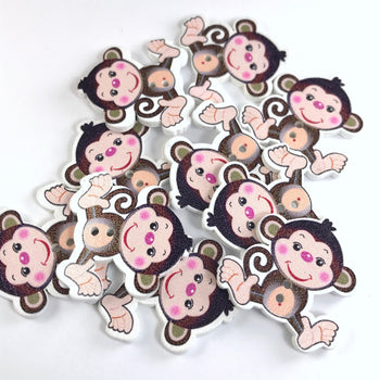 10 wooden buttons that look like monkeys
