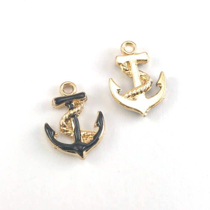 front and back of black and gold jewerly charms shaped like anchors