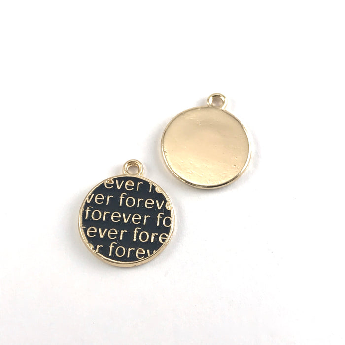 front and back of round black and gold charms with the word forever on them