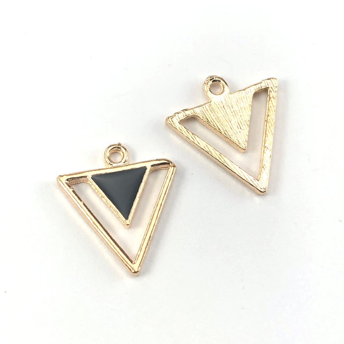 front and back of black and gold triangle shaped jewerly charms