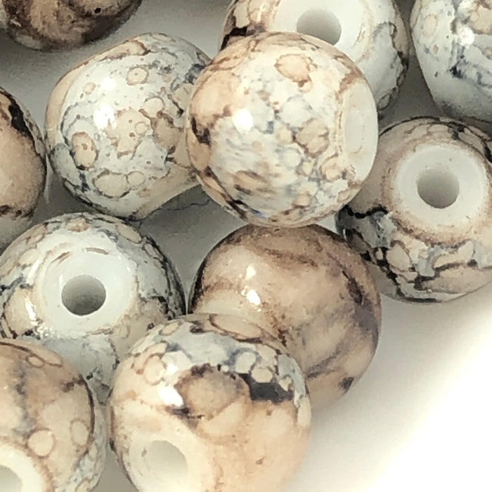 close up of grey and brown marble pattern round beads