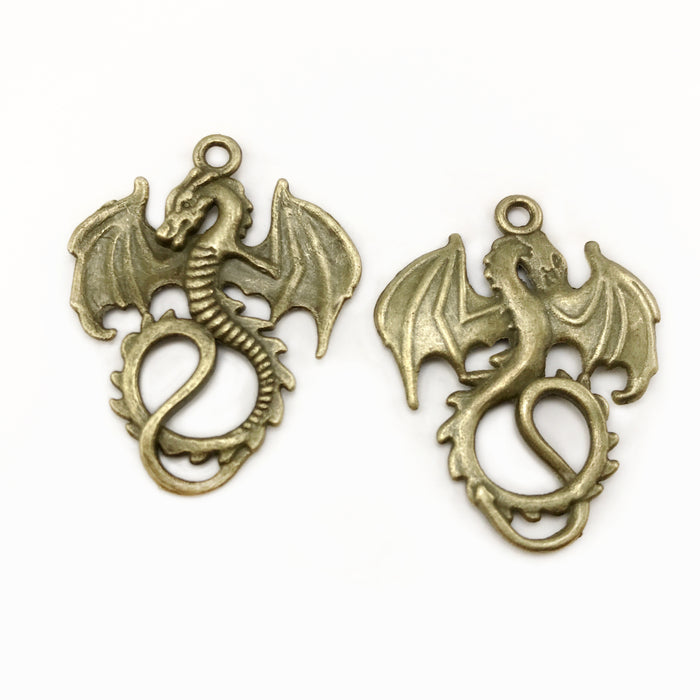 front and back of dragon jewelry pendants with antique bronze finish