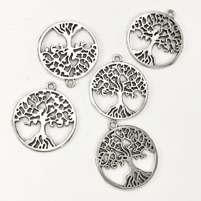silver colour jewelry charms that look like trees