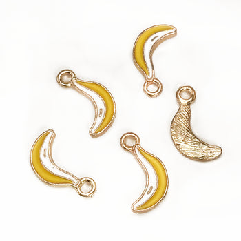 five jewelry charms that look like bananas