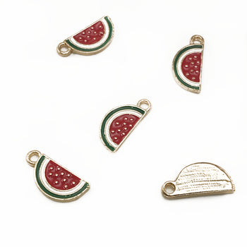 five jewelry charms that look like watermelon slices