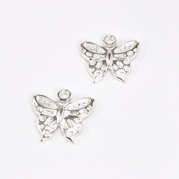 two jewerly charms shaped like butterflies