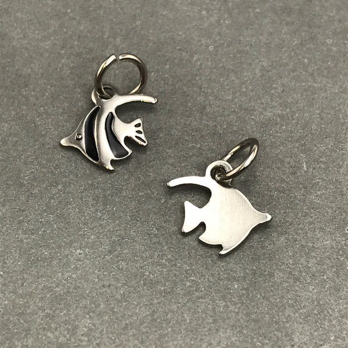 front and back of a stainles steel fish shaped jewelry charm