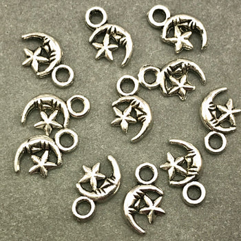 ten antique silver star and moon jewelry charms