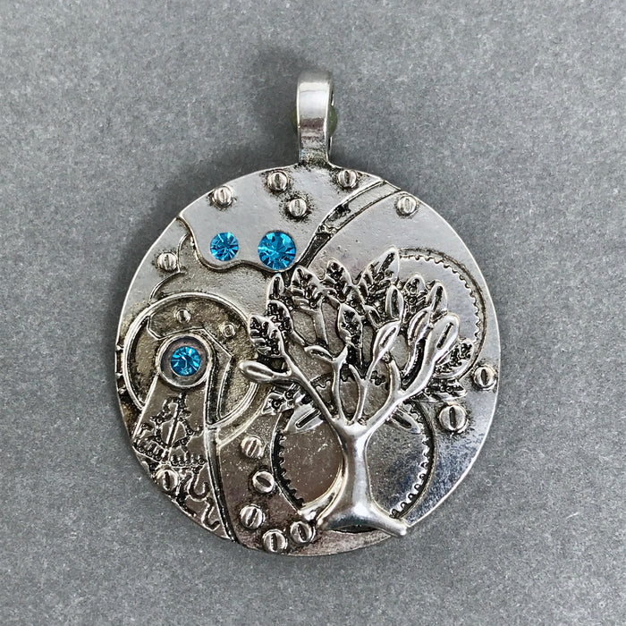 silver colour pendant with tree of life image and rhinestones