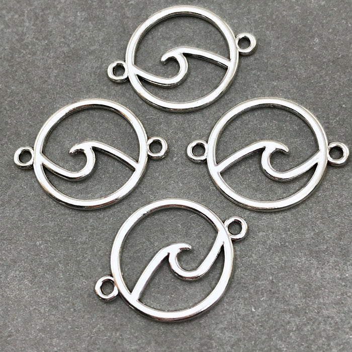 silver jewelry charms that are round with a wave design