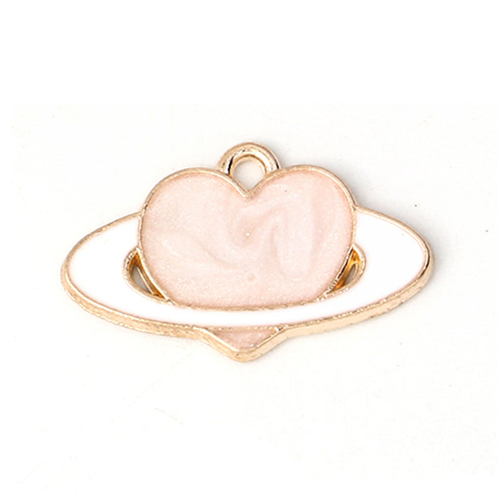 jewelry charms that are a pink heart with white planet ring