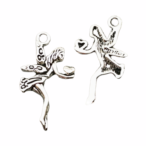 front and back of a jewelry charm of a fairy holding a heart