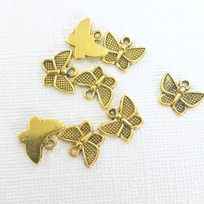 pile of jewelry charms shaped like butterflies