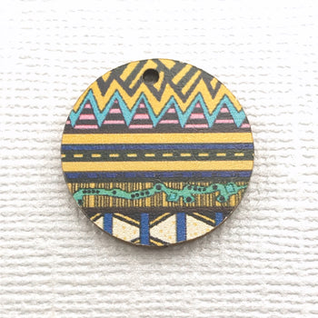 round wood jewelry charm with zentagle pattern printed on it