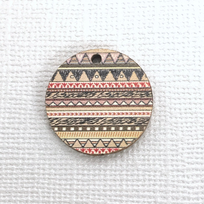 round wood jewelry charm with zig zag pattern