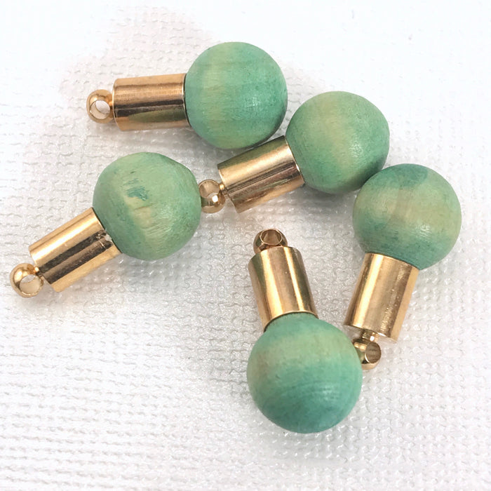 jewelry pendants that are a ball of green wood with gold accent