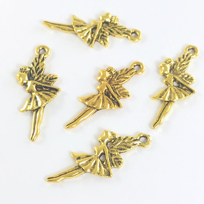 group of fairy shaped jewelry charms in a gold colour