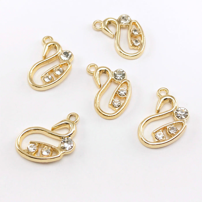 five gold colour jewelry pendants shaped like swans