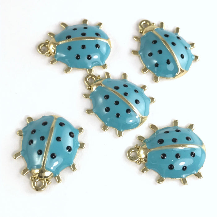 5 jewelry charms that look like ladybugs, blue and gold in colour