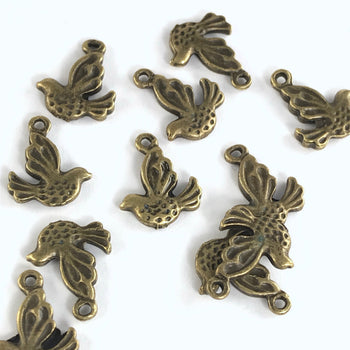 12 bronze jewelry charms that look like birds