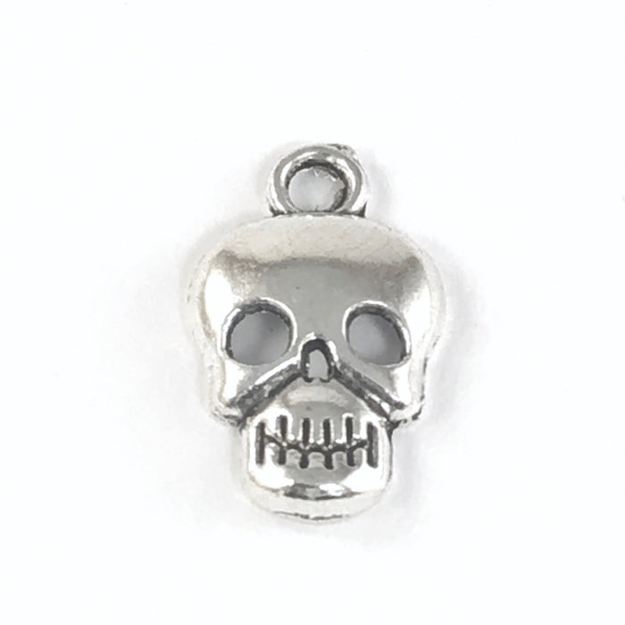 close up of a silver jewerly charm that looks like a skull