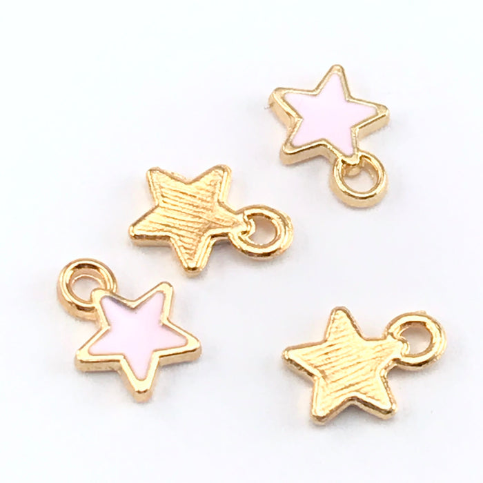 front and back of gold and pink charms that are star shaped