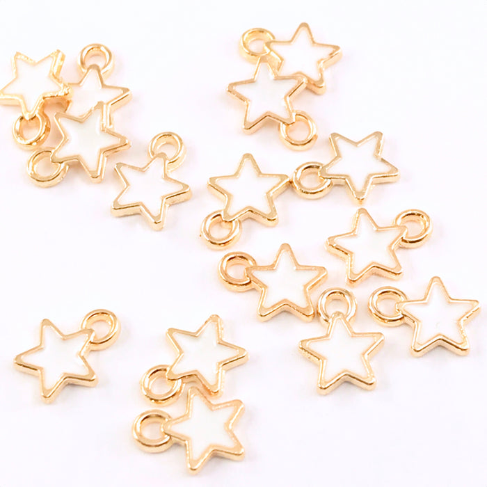15 white and gold star shaped charms