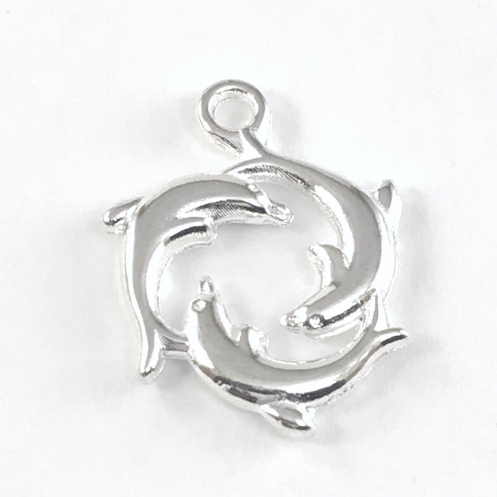 silver jewerly charm of 3 dolphins in a circle