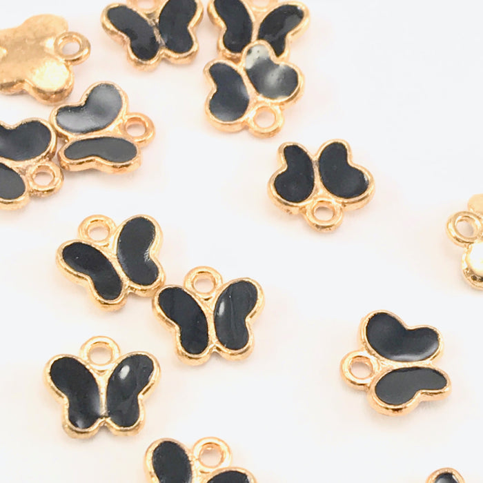 black and gold colour charms that are shaped like butterflies