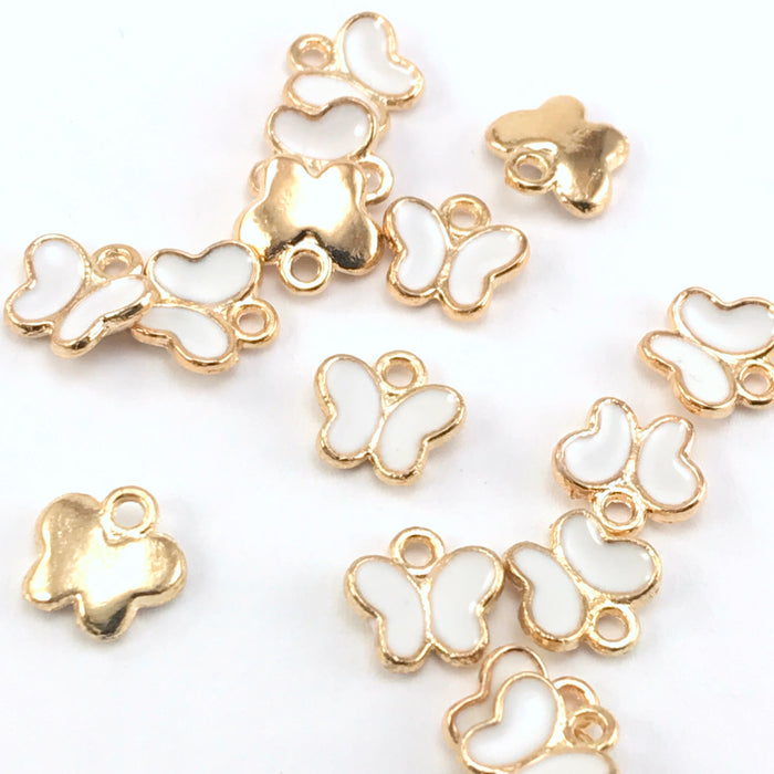 white and gold butterfly shaped charms