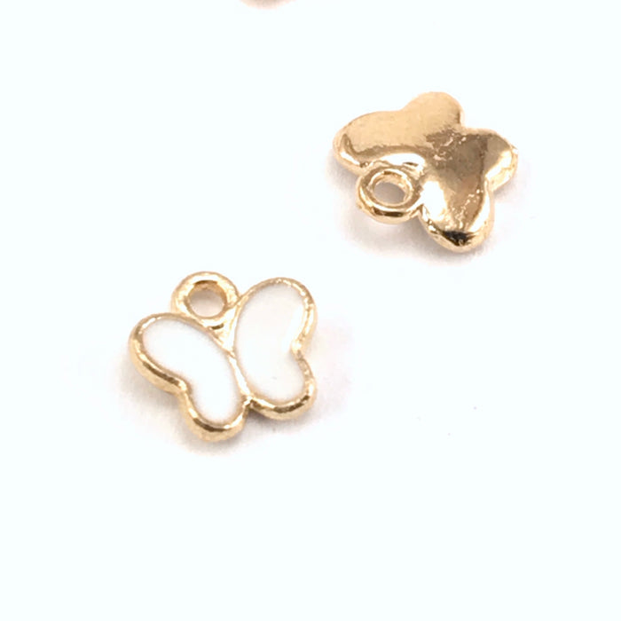 front and back of white and gold butterfly shaped jewerly charms