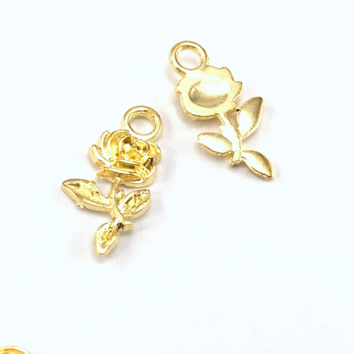 front and back of gold colour jewerly charm that looks like a rose