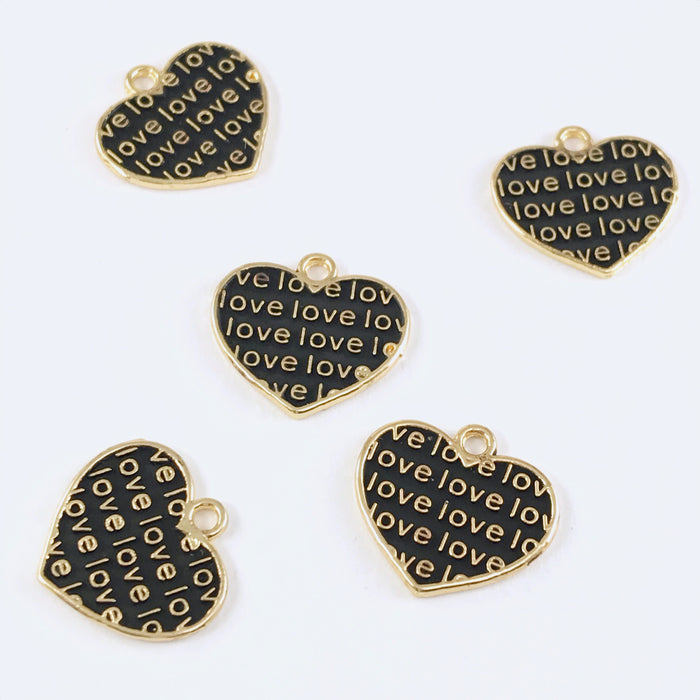 5 black and gold jewelry charms shaped like hearts with the word love on them