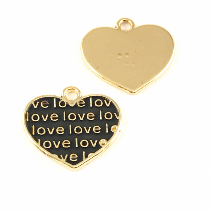 Front and back of black and gold jewelry charms shaped like hearts with the word love on them