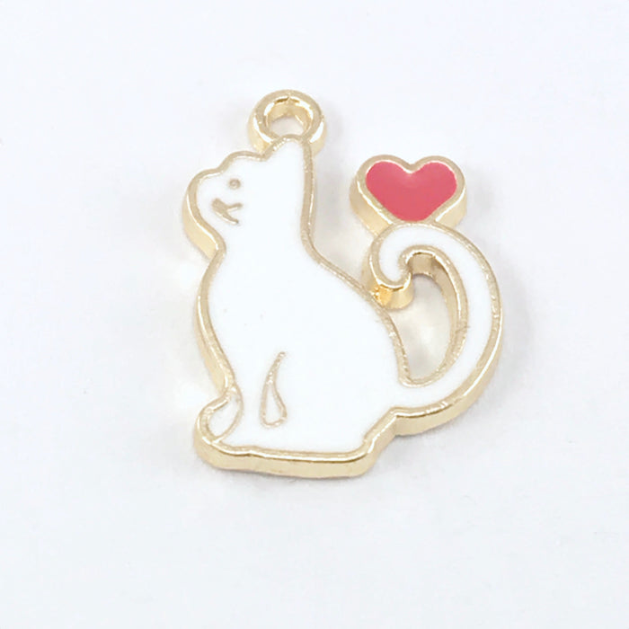close up of a white and gold jewelry charms that is shaped like a cat