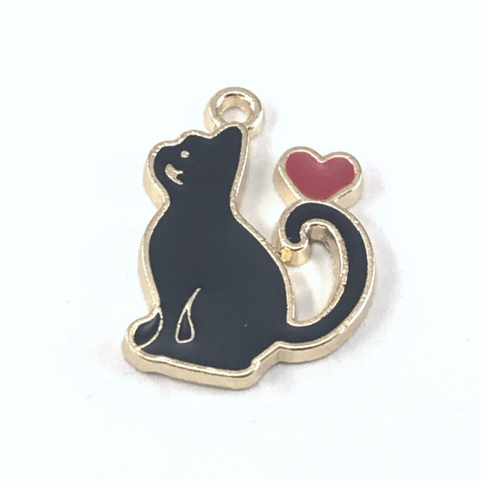 close up of a black and gold jewelry charm that is shaped like a cat