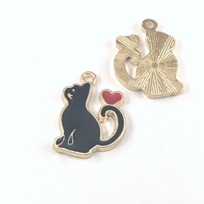 front and back of black and gold jewelry charms that are shaped like cats