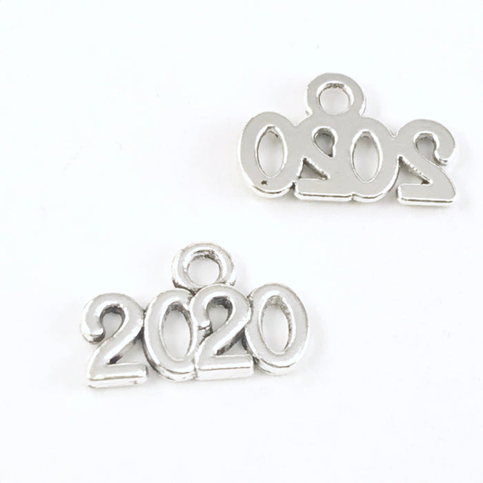 front and back of silver jewelry charms that say 2020