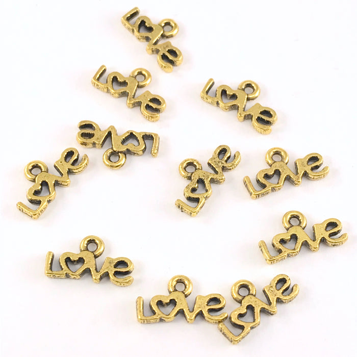 gold colour jewerly charms that say love